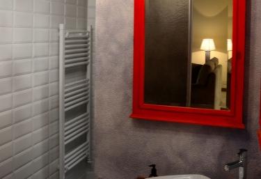 White-tiled toilet