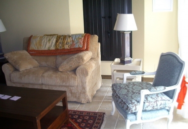 Living room with armchairs and low table