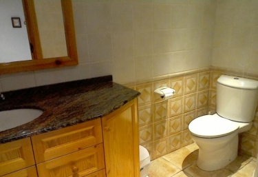 Toilet of the house with toilets and wooden cabinets