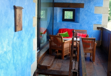 Terrace with furniture and blue walls